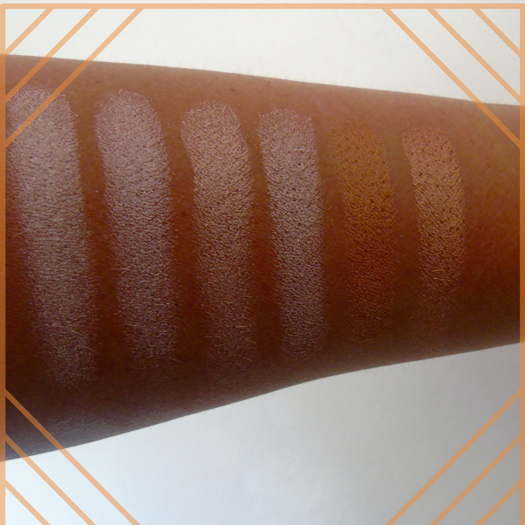 an arm showing colour swatches of a make up