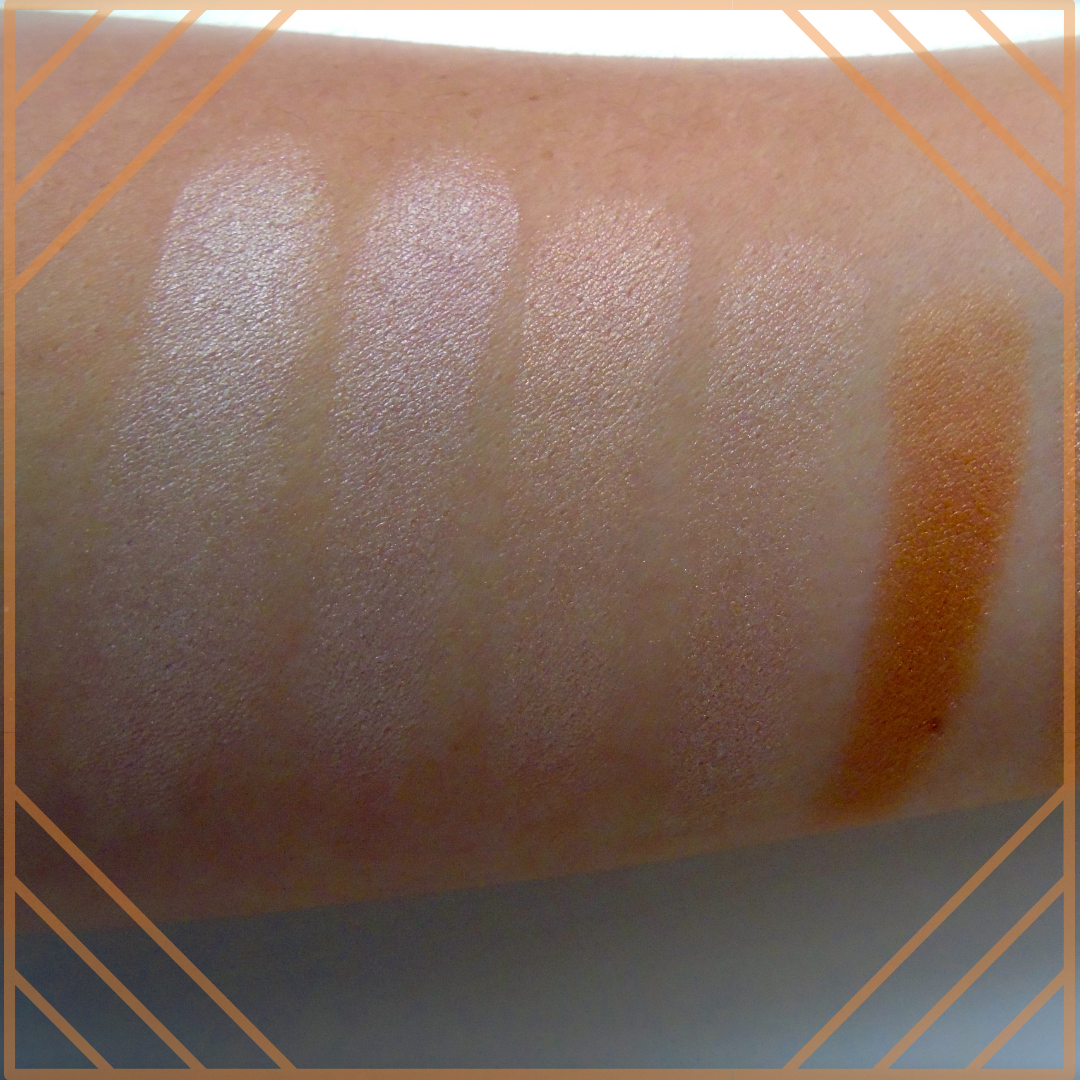 an arm showing colour swatches of make up