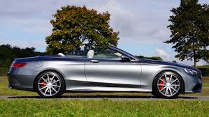 sports car with convertible roof in platinum silver colour