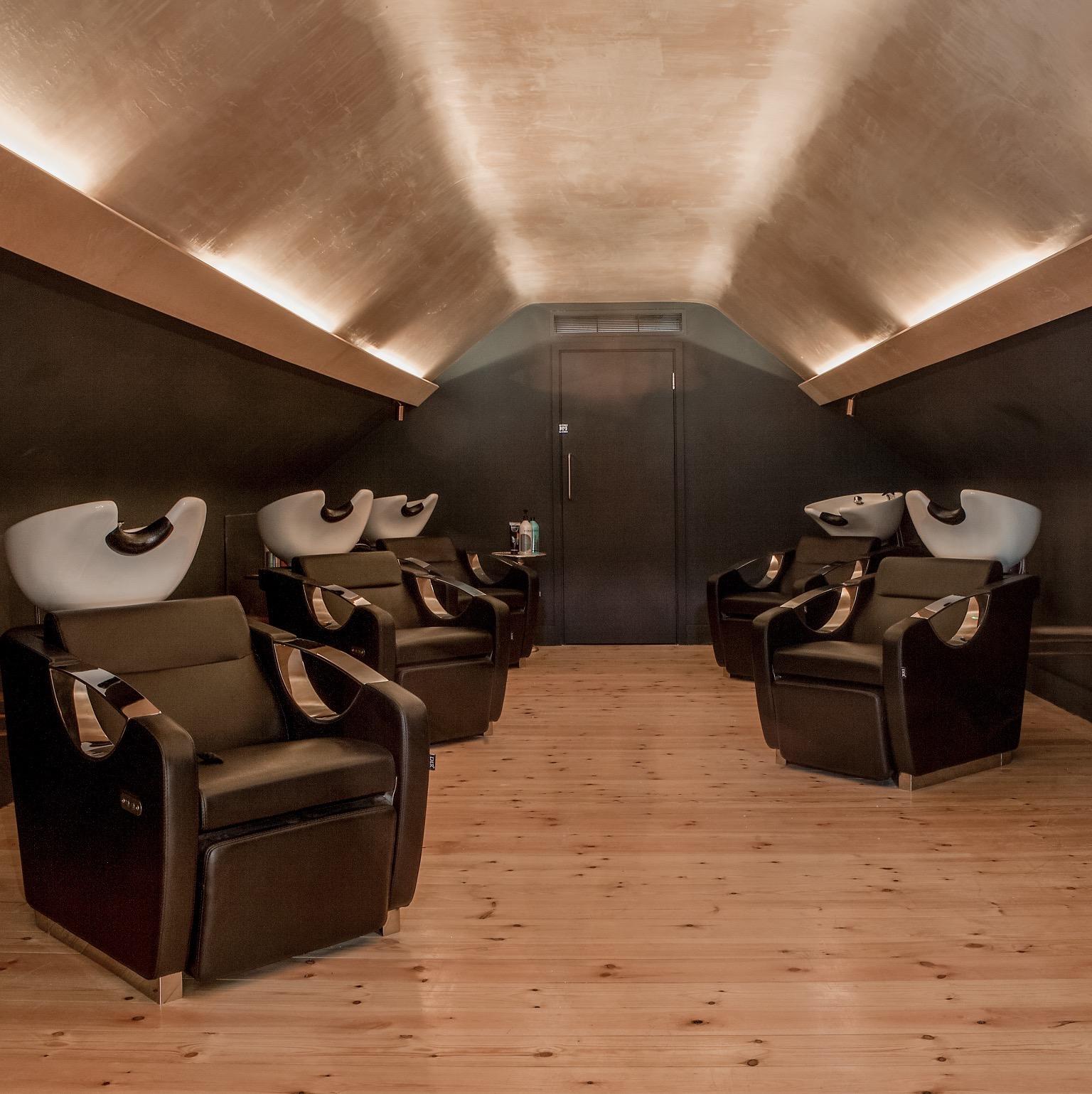salon wash basins in a dark tranquil area