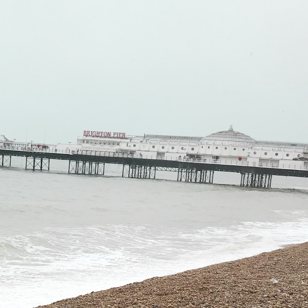 brighton palace pier image with the sea and some pebbles