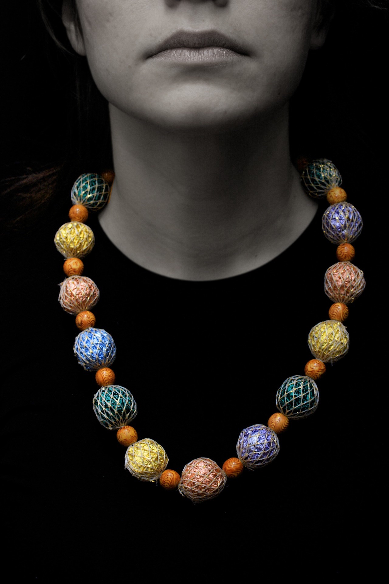 lady in a colourful necklace