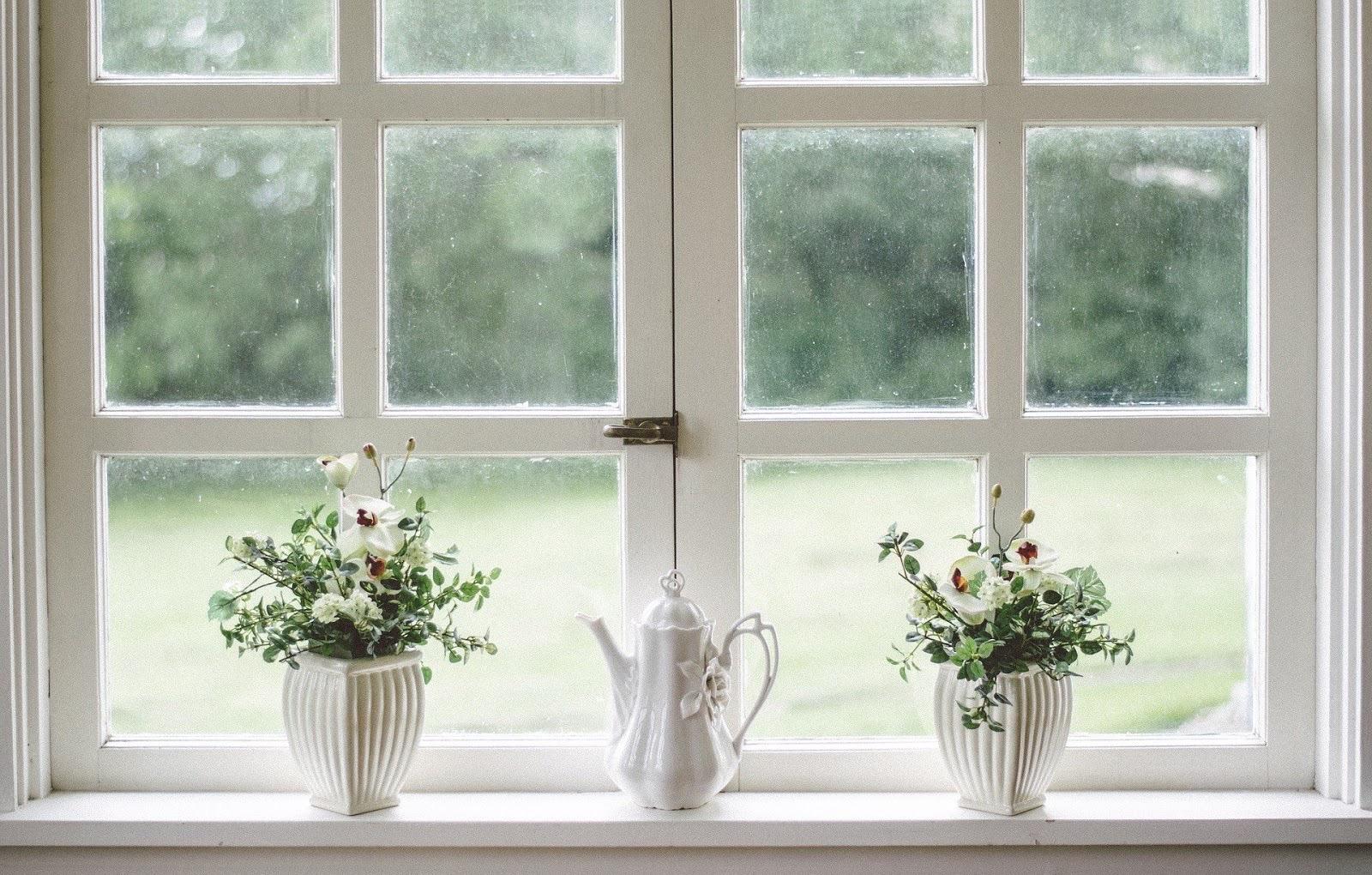 ornaments sitting on a window shelf