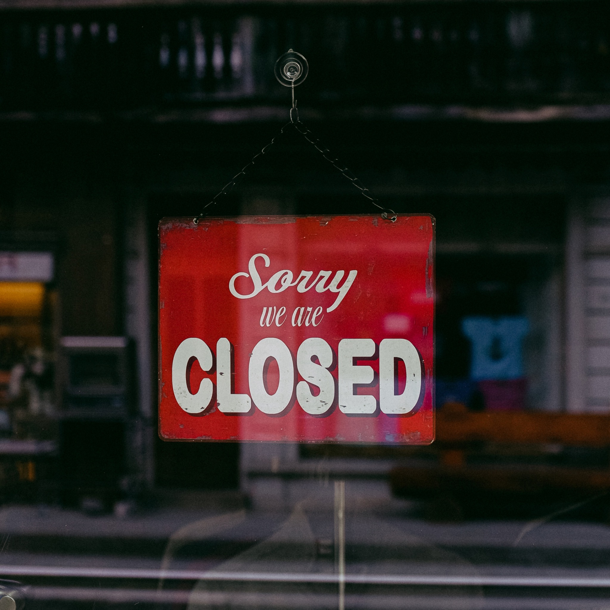 a shop door with a sign saying sorry we are close