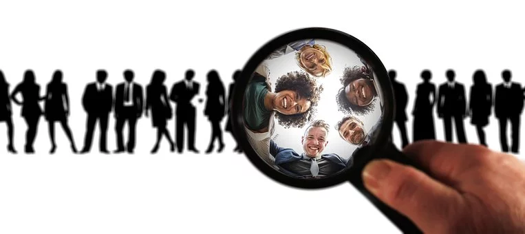 a magnifying glass looking over a group of people