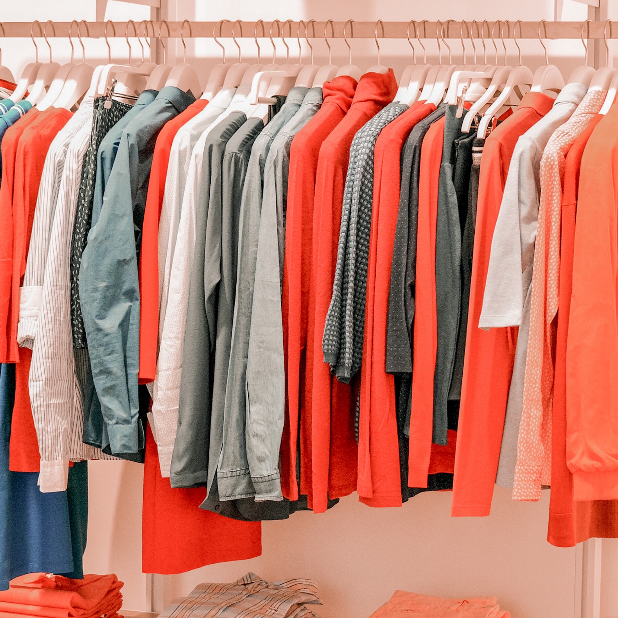 a clothes rail of tops