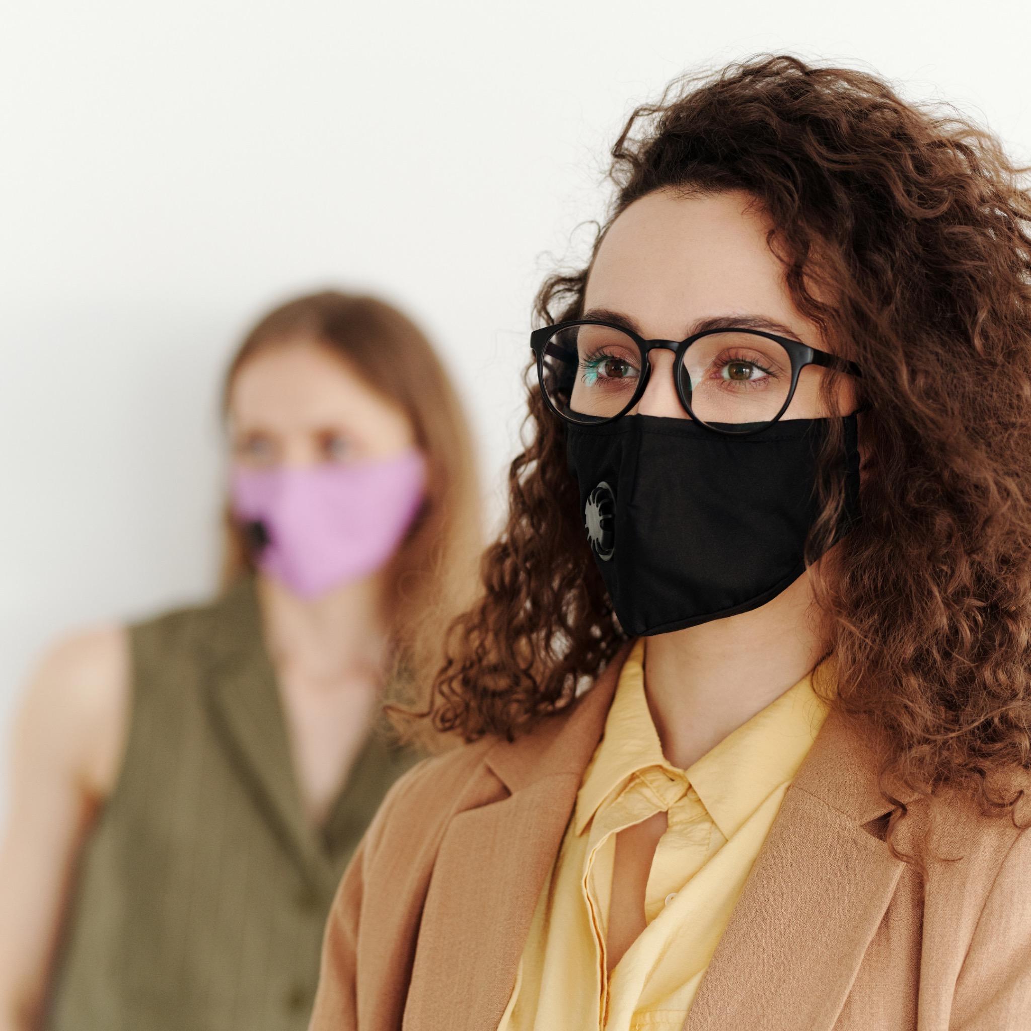 ladies wearing reusable face masks