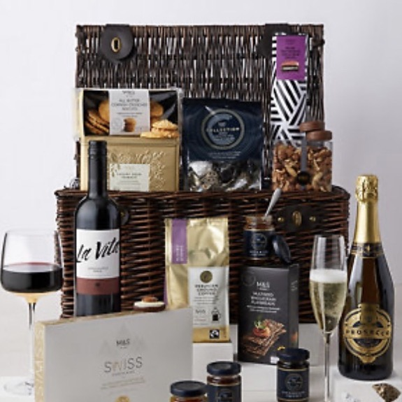 a luxury food hamper with treats and wine