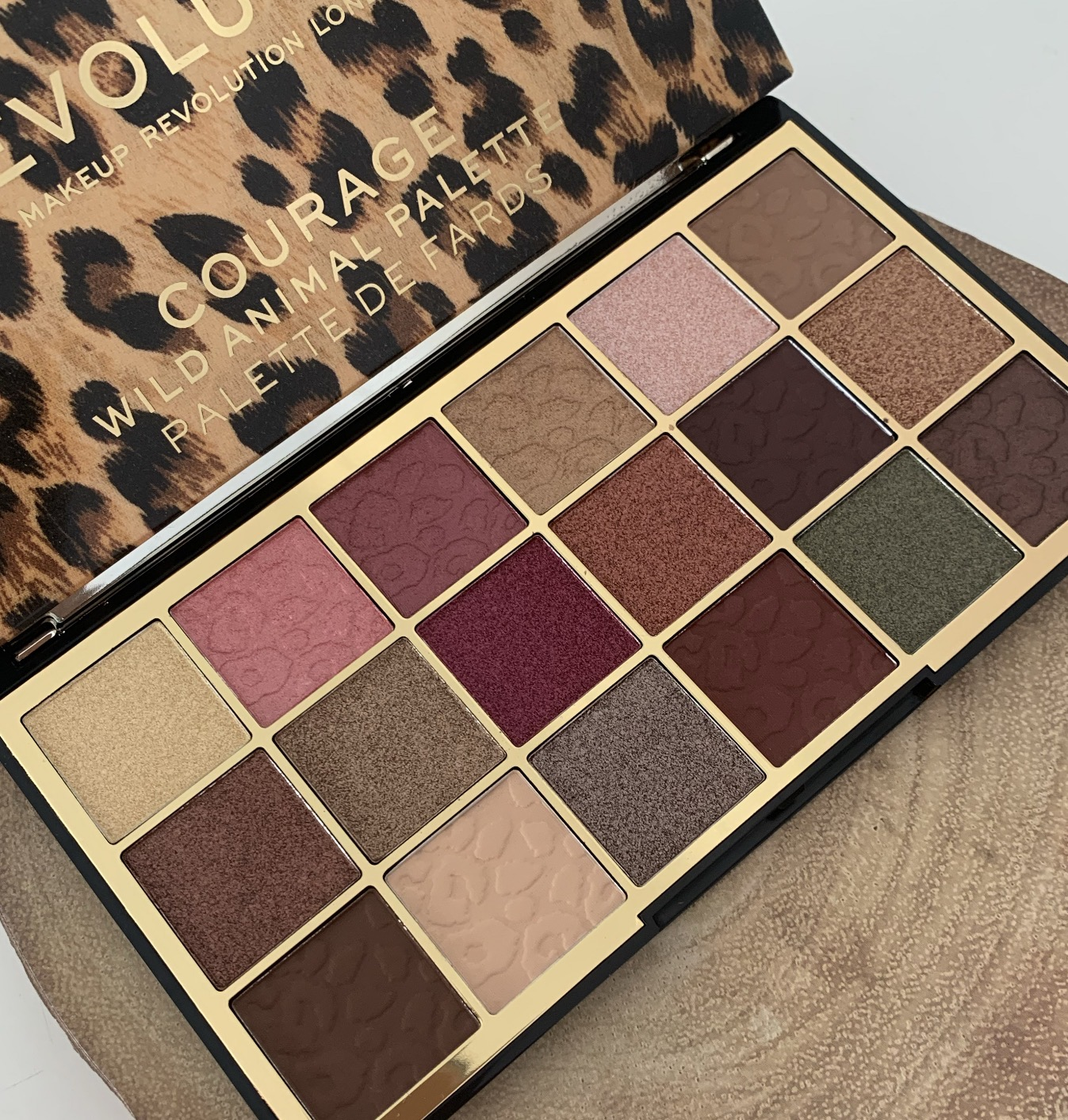 an eyeshadow palette opened up showing the colours