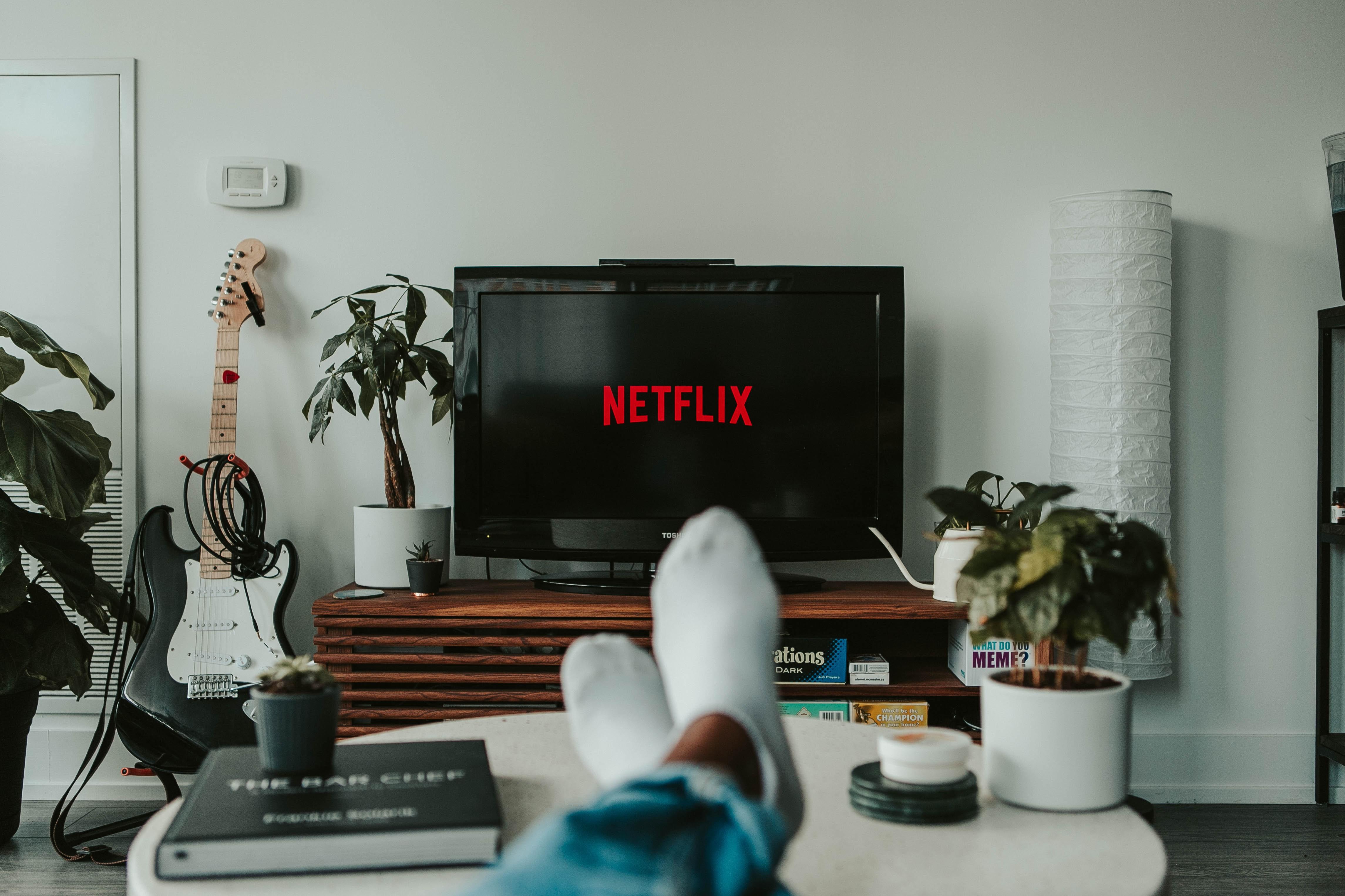 black flat screen turned on to Netflix logo
