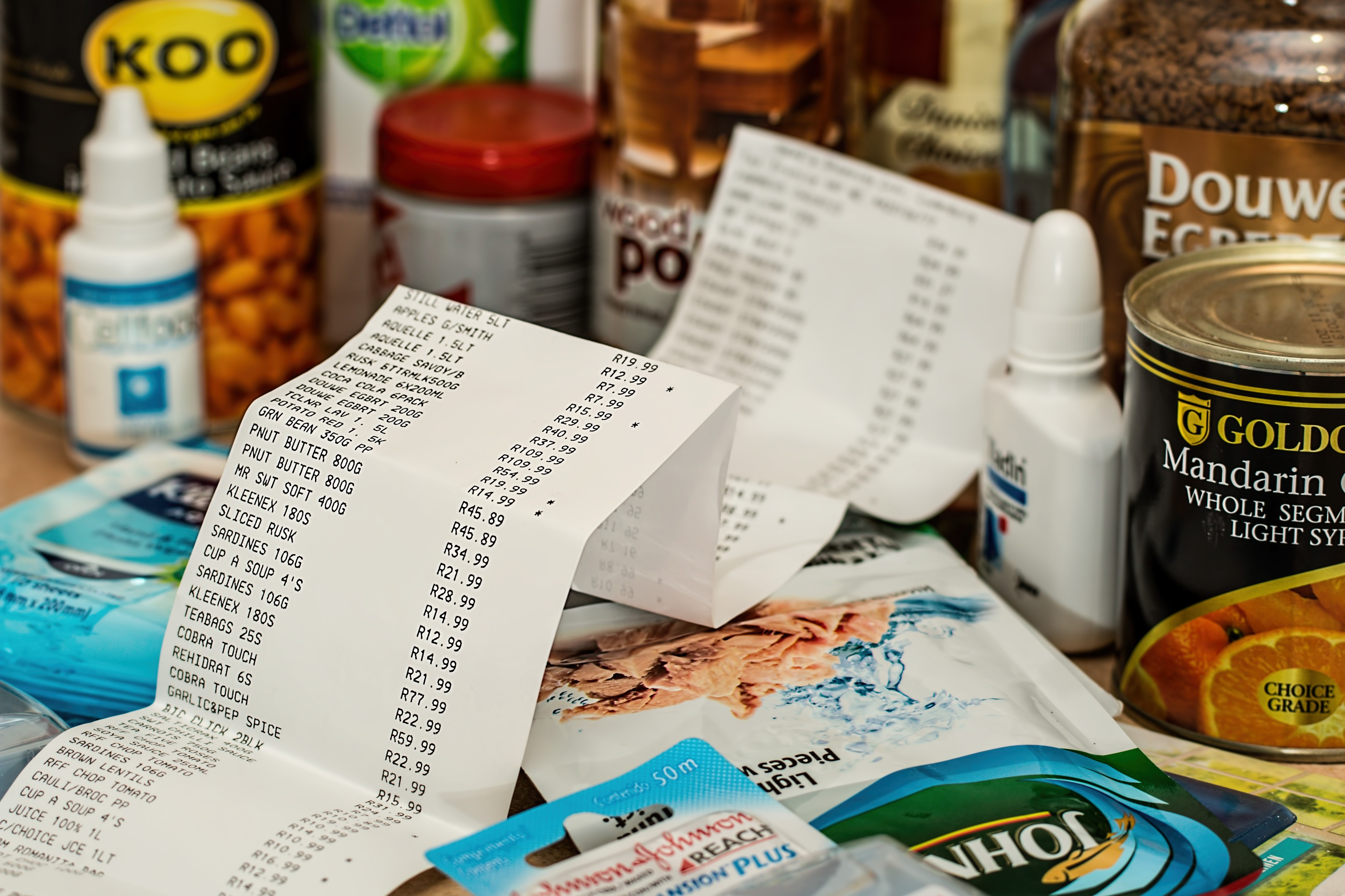 a shopping receipt scrunched up on a side along with some groceries