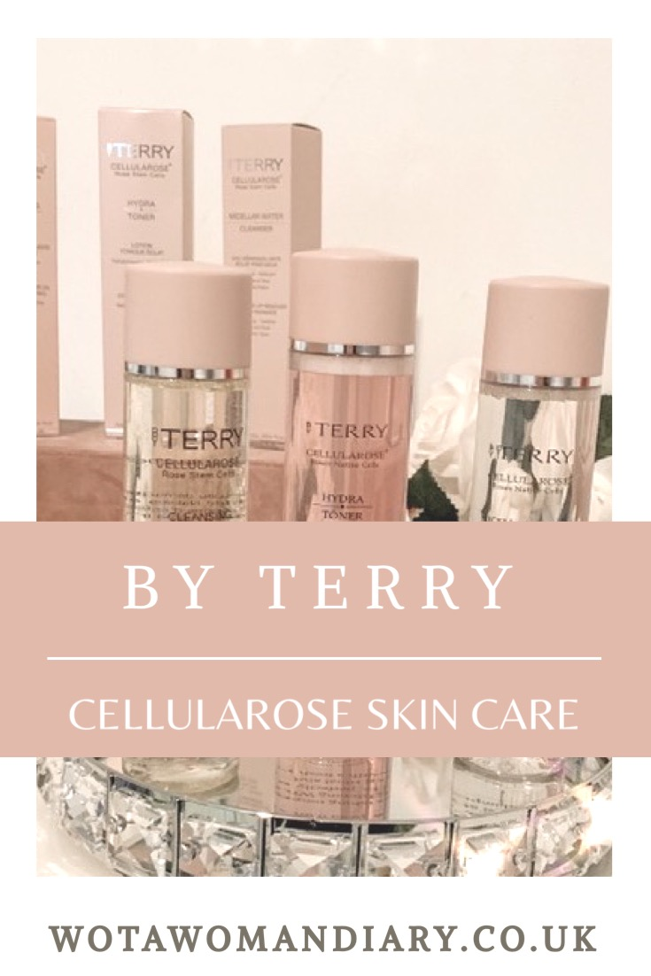 3 product bottles of by terry skincare sitting next to each other