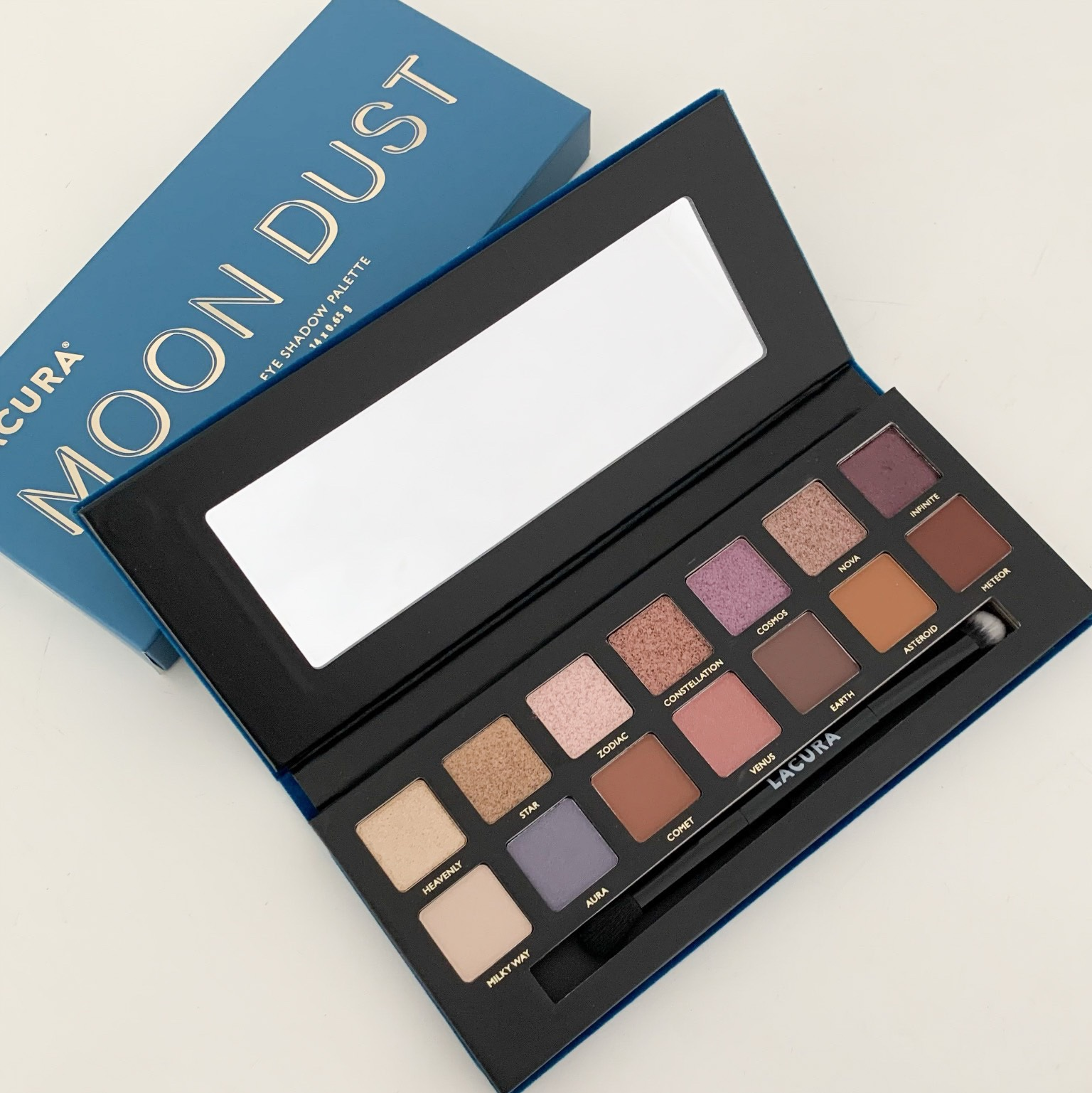 lacura moon dust eyeshadow palette open showing the colours of the pans